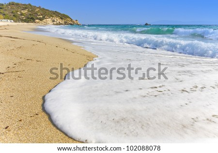 Sunny summer beach at the mediterranean coast in Greece - stock photo