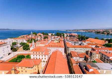 Sunny summer day above old town of Zadar. Panoramic view from the height at center of Zadar and red rooftops.