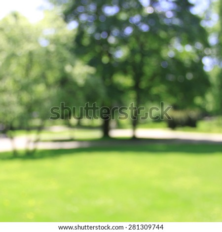 Sunny summer day natural bokeh of blurred park - stock photo
