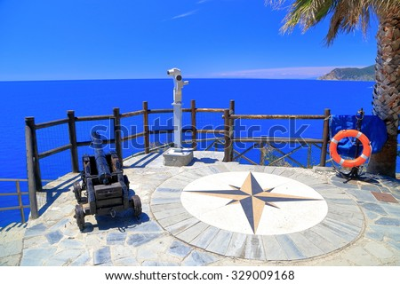 Sunny terrace with a telescope and old canon pointed to the sea, Manarola, Cinque Terre, Italy - stock photo
