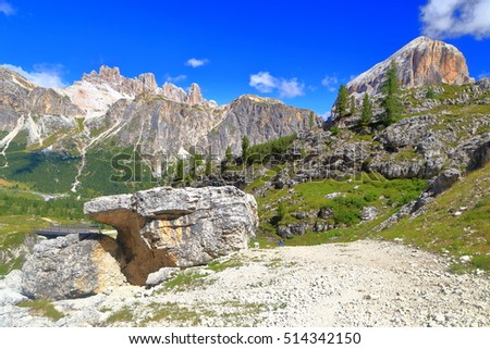 Sunny valley and distant summits of Fanes and Tofana, Dolomite Alps, Italy