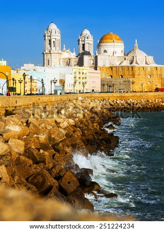 Sunny view of  Cathedral and  ocean coast. Cadiz, Spain   - stock photo