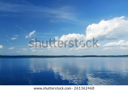 Sunny View on Blue Calm Lake - stock photo