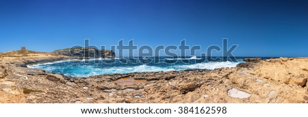 Sunny wide panoramic view of rocky Dweira bay in Gozo, Malta.