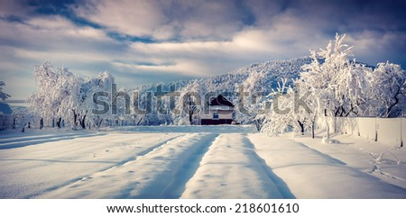 Sunny winter landscape in the mountain village - stock photo