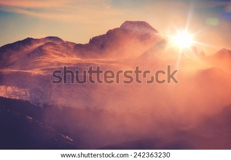 Sunny Winter Mountain Landscape with Blowing Snow. Colorado Rocky Mountains, Colorado, United States. - stock photo