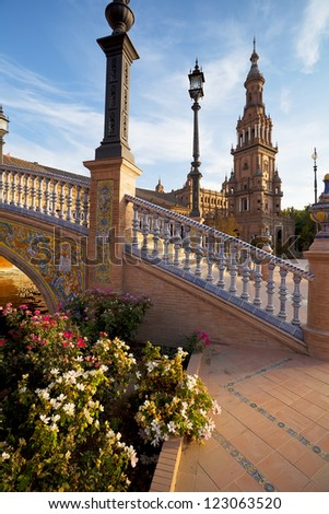 sunny with flowers Plaza de Espana in Sevilla, Spain