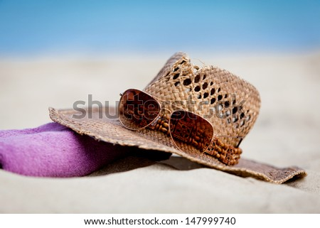 sunprotection objects on the beach in holiday sunglasses hat suncare - stock photo