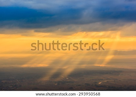 Sunray from tope of mountain view - stock photo