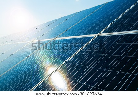 Sunray reflecting on solar power photovoltaic panel as green and renewable electric energy solution concept - stock photo