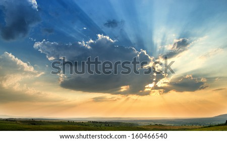 Sunrays sunset in late summer - stock photo