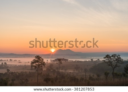 Sunrise above the mountain and misty forest on the morning.