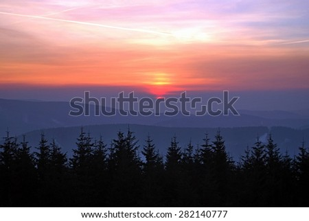 sunrise above winter mountains
