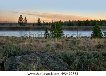 Sunrise along the Madison River in Yellowstone National Park Wyoming.