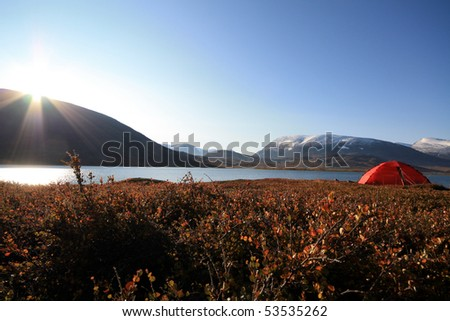 Sunrise and a Tent on the Kungsleden in Sweden - stock photo