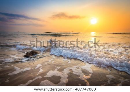 Sunrise and beach - stock photo