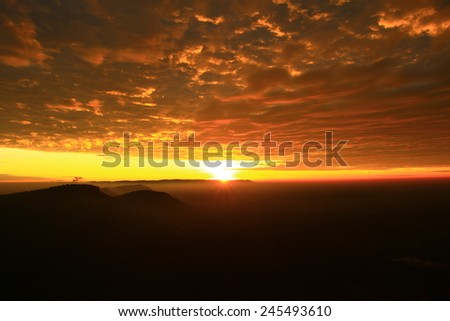 Sunrise and fog rolling over Pha Mo E Dang Mountain at Khao Pra Wihan National Park, Thailand. - stock photo