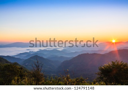 sunrise and morning mist in valley, North of Thailand - stock photo