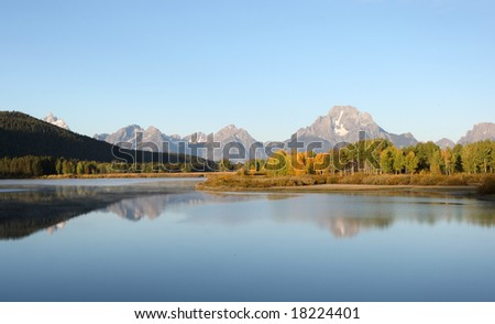 Sunrise and Reflection on Teton Mountain in Grand Teton National Park