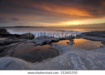 Sunrise and reflections at Yena located in Botany Bay National Park lpart of the Kurnell Peninsula.  Views north east  - stock photo