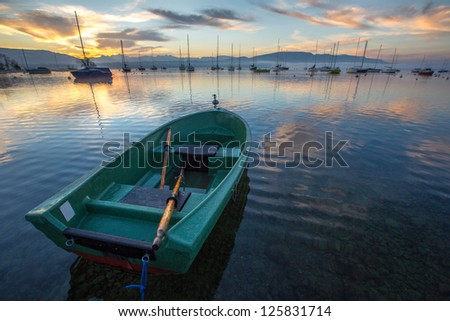 Sunrise and sailboats at a small bay in lake Geneva, Switzerland