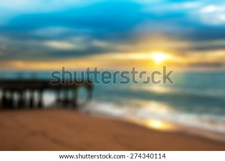 Sunrise and sea beach over the bridge in blurred backgroud - stock photo