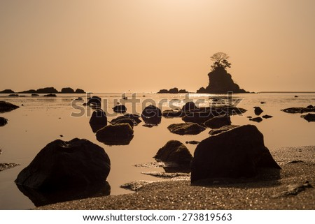 Sunrise and sea rock