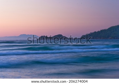Sunrise and waves at golden beach, Thassos island in Greece