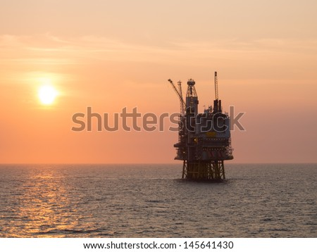 Sunrise at an offshore oil platform on the North Sea, in the Norwegian sector