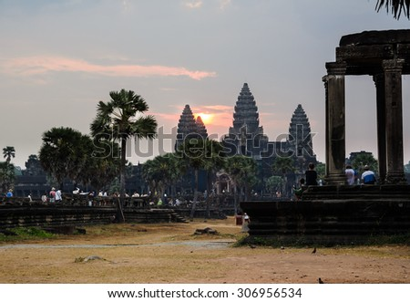 Sunrise at Angkor Wat, part of Khmer temple complex, popular among tourists ancient landmark and place of worship in Southeast Asia. Siem Reap, Cambodia. - stock photo