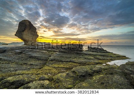 Sunrise at Batu Payung (Umbrella Rock) at Lombok, Indonesia - stock photo