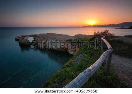 Sunrise at cliff seascape - stock photo