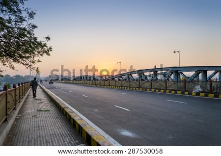 Sunrise at Ellis Bridge in Ahmedabad, Gujarat, India - stock photo