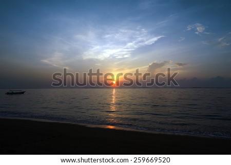 Sunrise at Geger Beach, Bali Island, Indonesia - stock photo