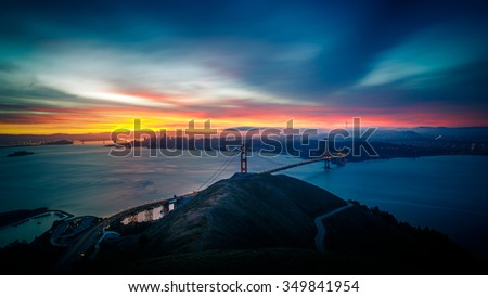 Sunrise at Golden Gate Bridge and city of San Francisco, California, USA - stock photo