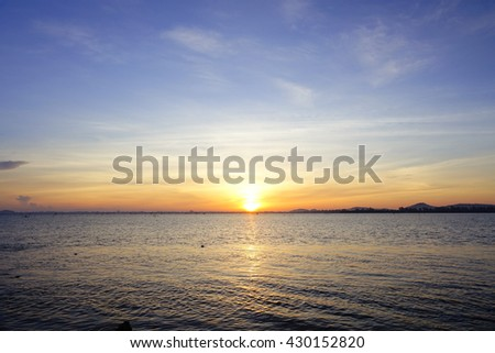 Sunrise at Lake,select focus with shallow depth of field:Soft focus,noise and grain due long exposure:ideal use for background.  - stock photo