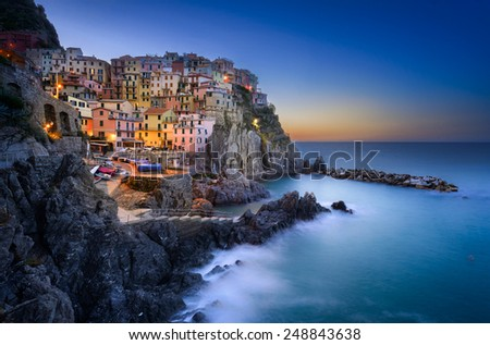 Sunrise at Manorola, Cinque Terre, a small jewel village by mediterranean coast line - stock photo