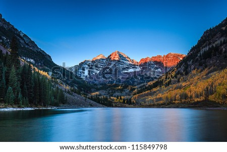 Sunrise at Maroon Bells with Fall color, Colorado - stock photo