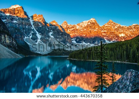 Sunrise at Moraine Lake in Banff National Park (Canada, about 5:30 am in June) - stock photo