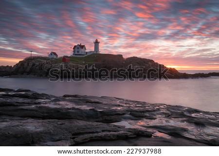 Sunrise at Nubble Lighthouse, Cape Neddick, York, Maine, USA - stock photo