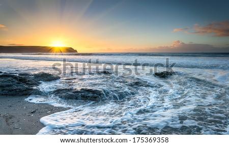 Sunrise at Pendower beach on the Roseland Peninsula in Cornwall - stock photo