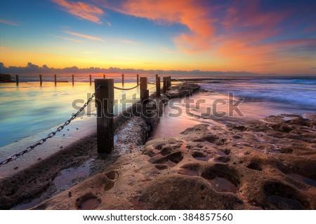 Sunrise at sea with beautiful twilight sky - stock photo