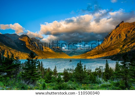 Sunrise at St. Mary Lake from Wild goose island viewpoint, Glacier National Park, Montana - stock photo