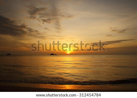 sunrise at the beach - stock photo