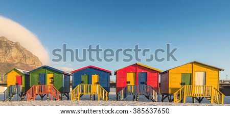 Sunrise at the famous colorful beach huts at Muizenberg Beach outside Cape Town, South Africa - stock photo