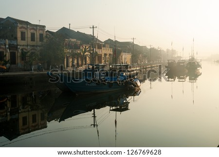 Sunrise at the harbor of Hoi An, an UNESCO World Heritage site in Vietnam - stock photo