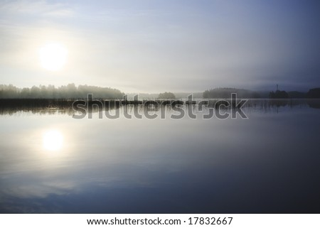 Sunrise at the lake in eastern part of Finland - stock photo