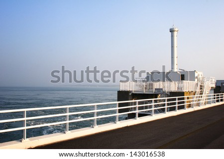 Sunrise at the Oosterschelde water barrier in the Netherlands. - stock photo