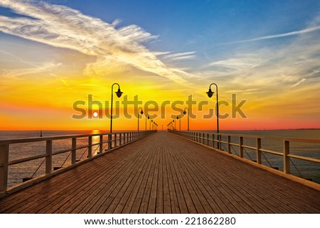 Sunrise at the pier in Orlowo, Poland.  - stock photo