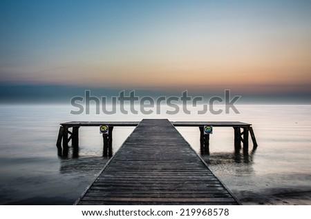Sunrise at the pier in Sopot, Poland. - stock photo